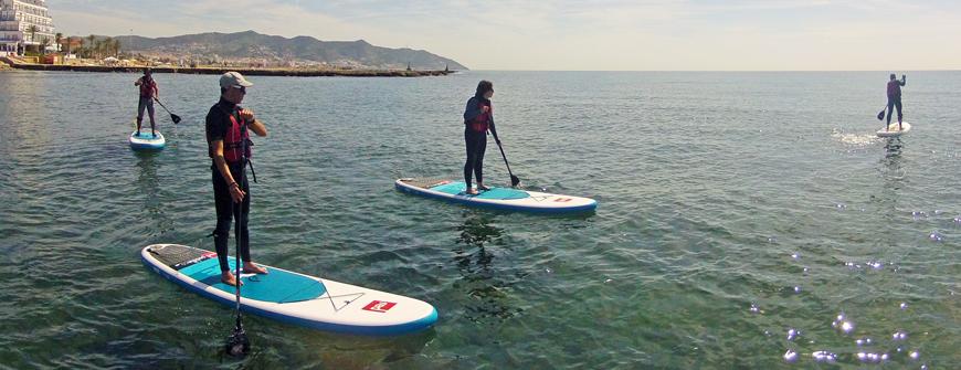Paddle kayak school in Sitges Beach aquines